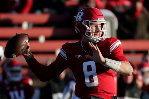 f7d6bc431 Rutgers quarterback Artur Sitkowski looks to pass against Michigan during  the first half of an NCAA