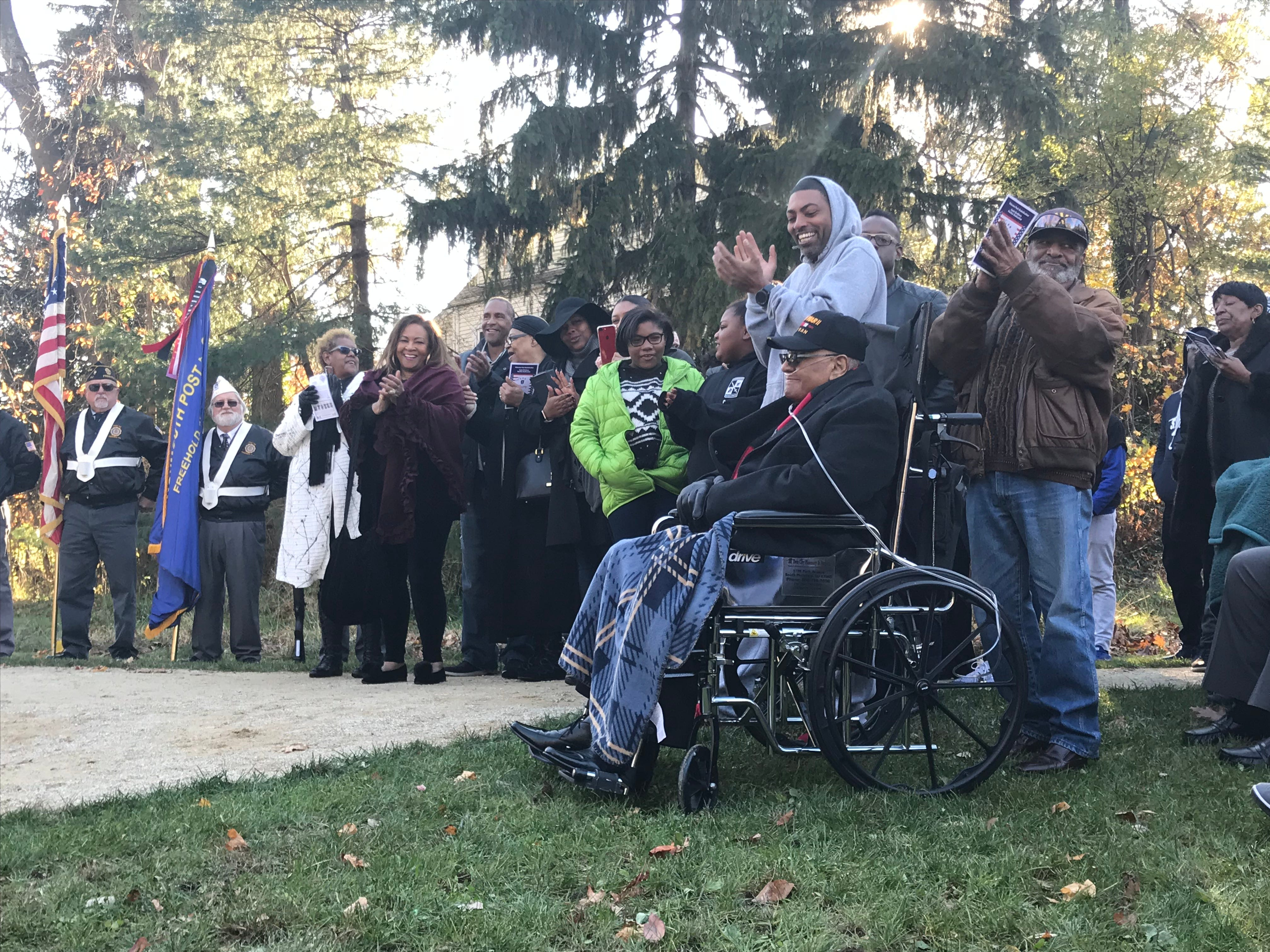 """A crowd of more than 100 people clap for Bigerton """"Buddy"""" Lewis, a private in the 1317th Engineer General Service Regiment in World War II, on Sunday, Nov. 11, 2018 at Veterans Park in Freehold Borough. A pavilion at the park was named after Lewis and his five late brothers, who all served in the war."""
