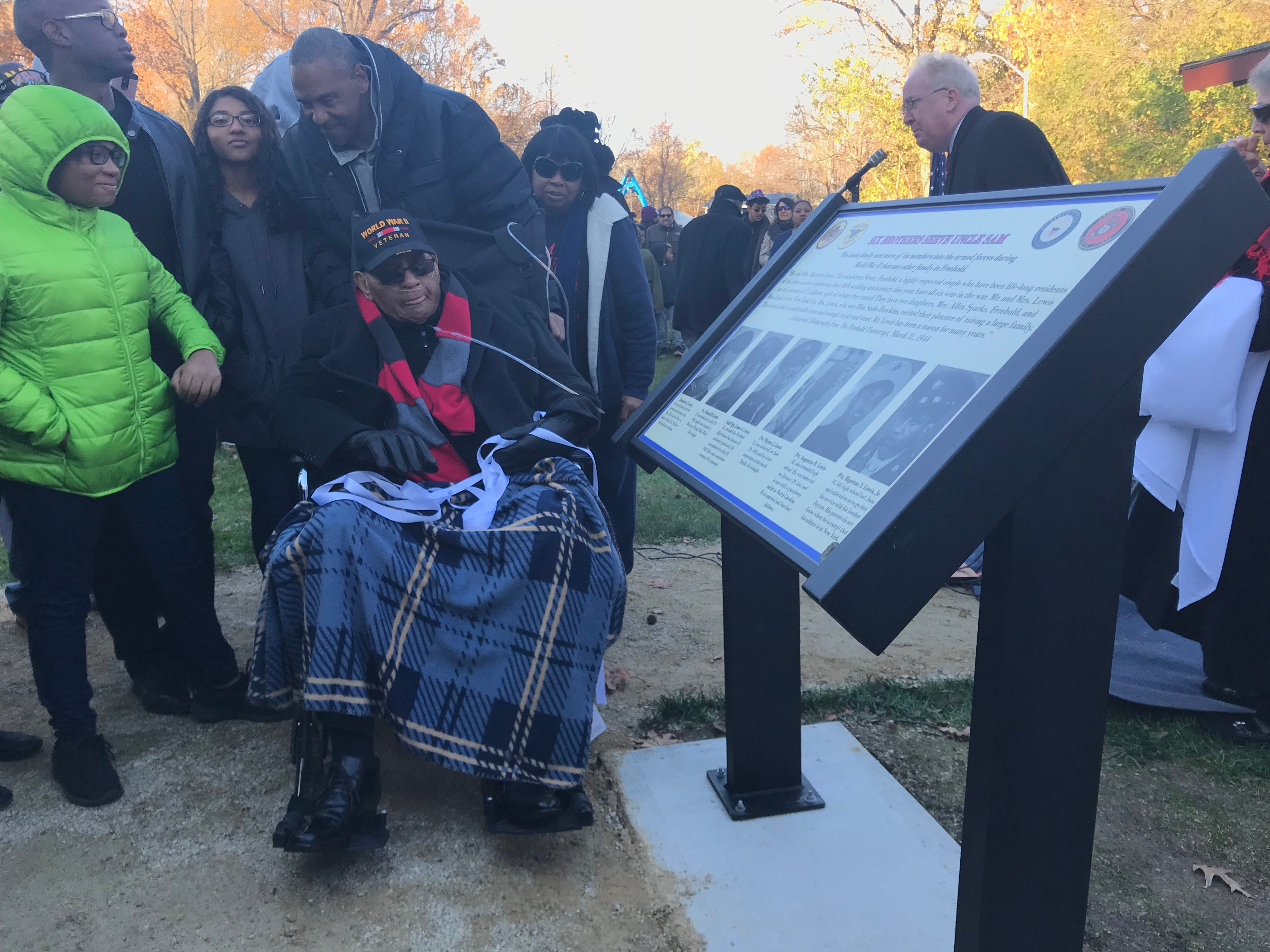"""Bigerton """"Buddy"""" Lewis Jr., gets his first look at the marker at Freehold's Veterans Park that is dedicated to him and his five late brothers, who all served in World War II."""