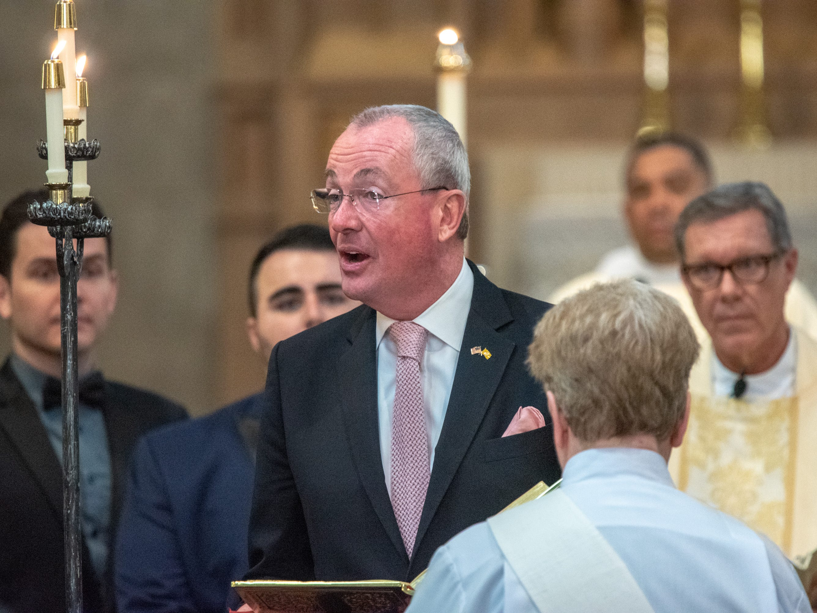 Gov. Phil Murphy read at the ceremony. Christian Fuscarino, (visible on the left shoulder of governor) Executive Director of Garden State Equality, and U.S. Marine Corporal Aaron Williams (at right) were married at Trinity Church in Asbury Park on Sunday, November 11, 2018.  / Russ DeSantis f