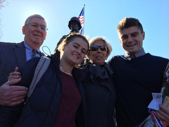 From right to left: Gen. Rockafeller's great-grandson Kyle Henry, daughter Pam Rockafeller Henry, great-granddaughter Emerson Henry and son-in-law Rob Henry, in front of the freshly-unveiled statue.