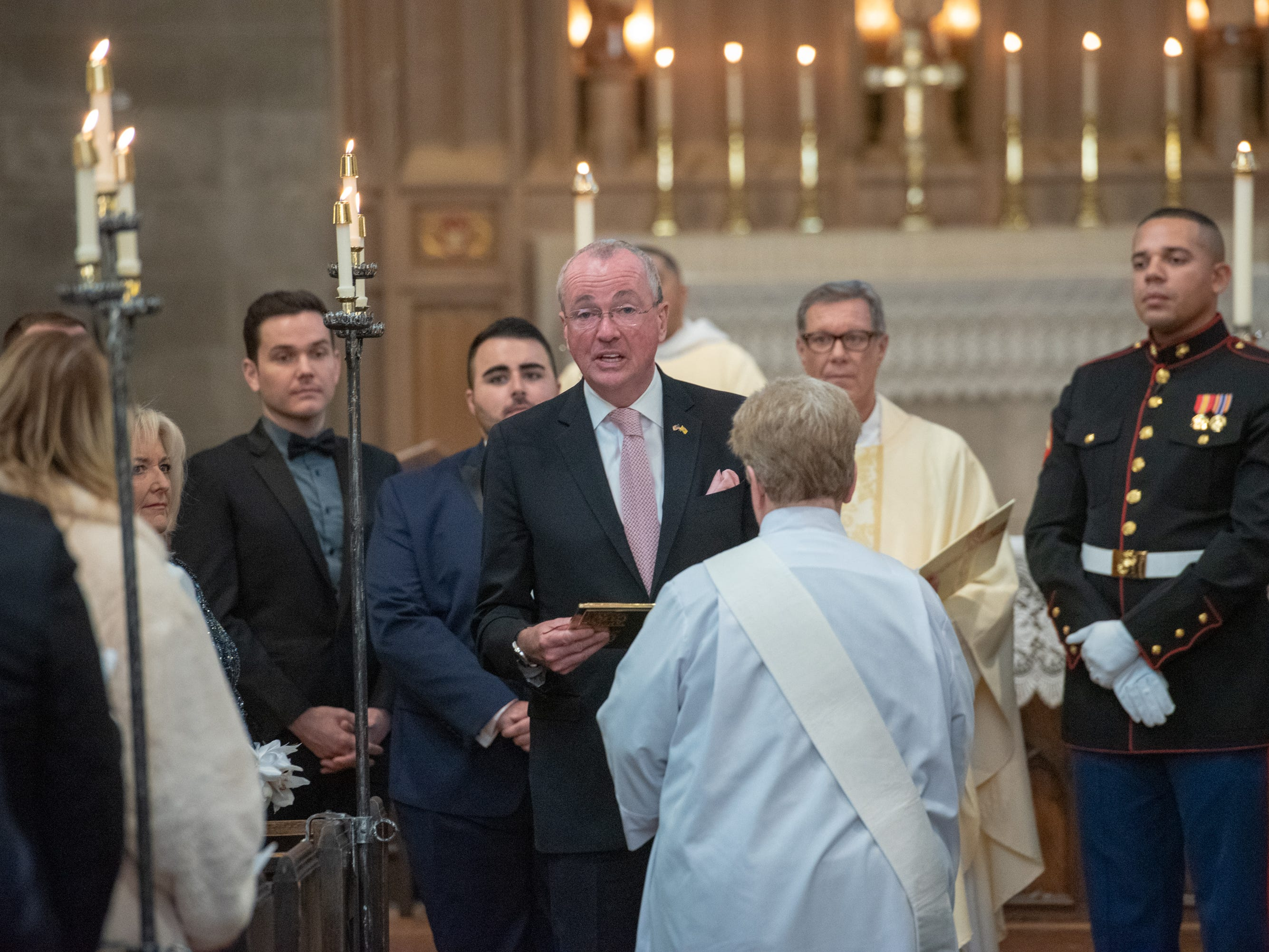 Gov. Phil Murphy read at the ceremony. Christian Fuscarino, (visible on the left shoulder of the governor) Executive Director of Garden State Equality, and U.S. Marine Corporal Aaron Williams (at right) were married at Trinity Church in Asbury Park on Sunday, November 11, 2018.