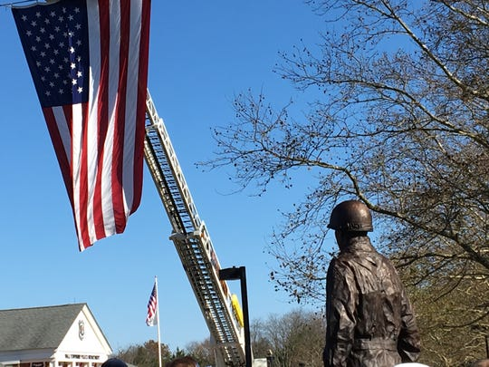 A statue to Gen. Harry Rockafeller is unveiled at Wall Police Headquarters.