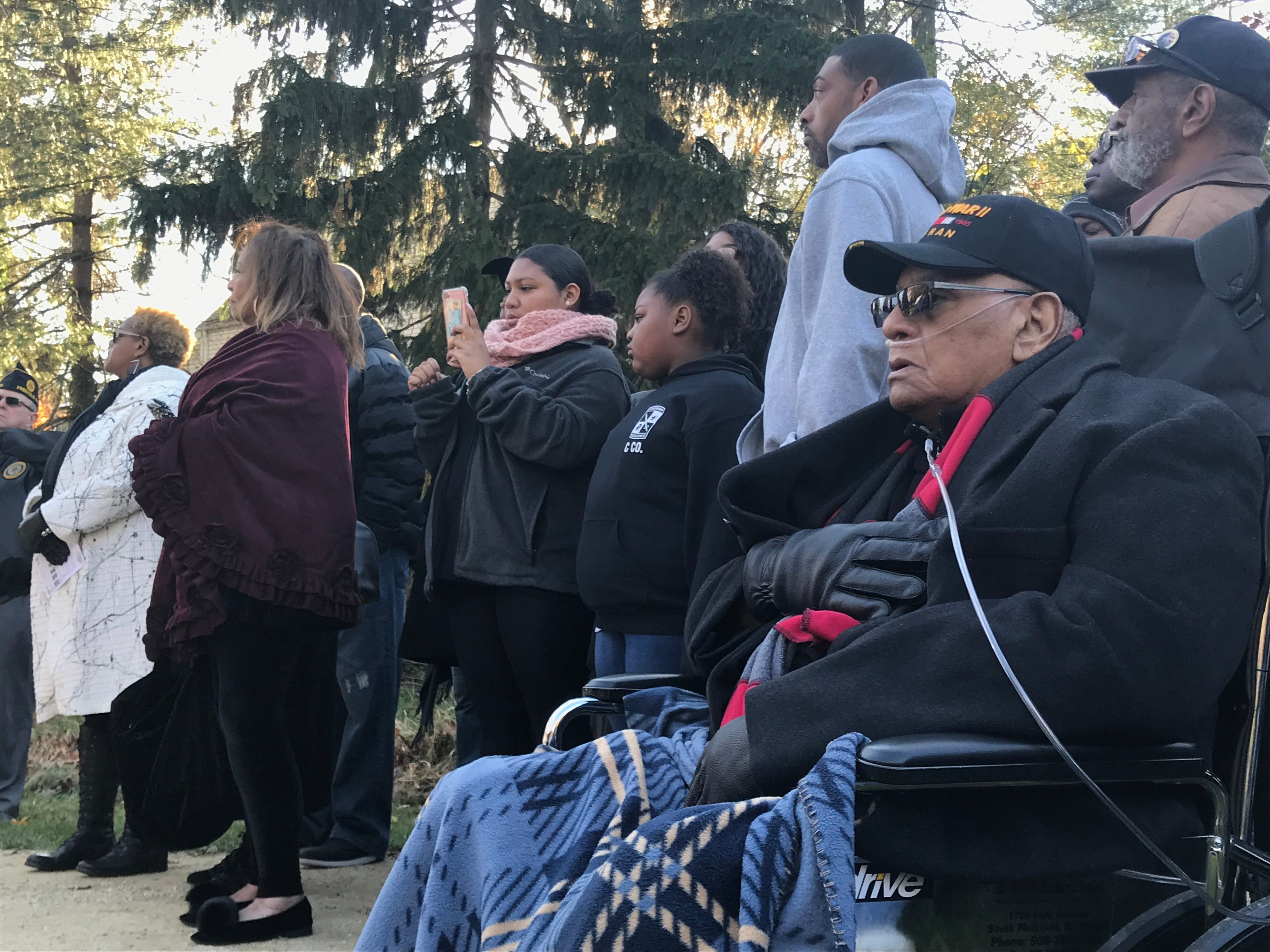"""Bigerton """"Buddy"""" Lewis Jr. placed his hand over his chest as Courtneney Wilds sings the national anthem on Veterans Day, Nov. 11, 2018 at Veterans Park in Freehold Borough. The ceremony commemorated Lewis and his five brothers who served in World War II."""