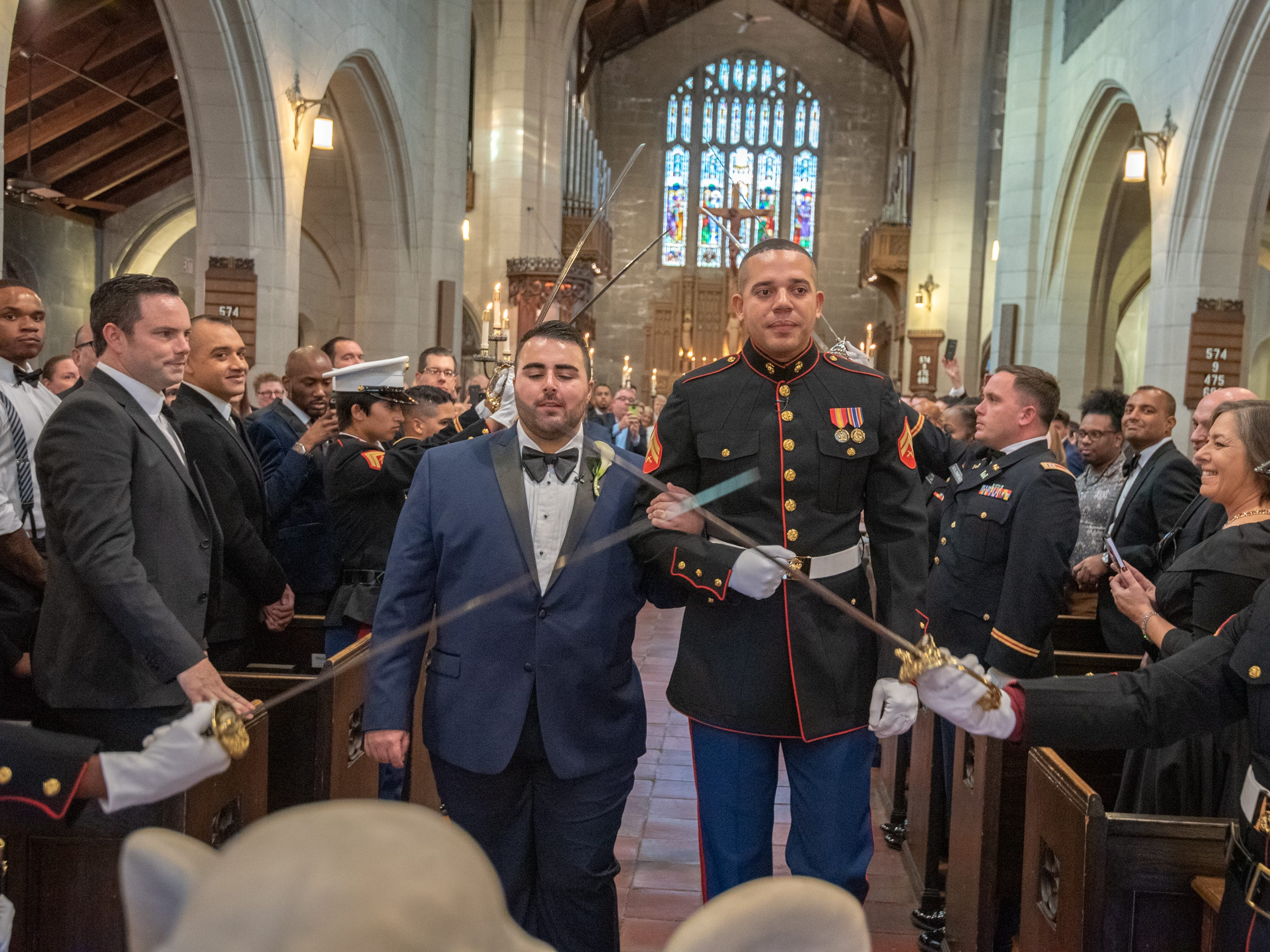 Christian Fuscarino, (left) Executive Director of Garden State Equality, and U.S. Marine Corporal Aaron Williams (in uniform) were married at Trinity Church in Asbury Park on Sunday, November 11, 2018.