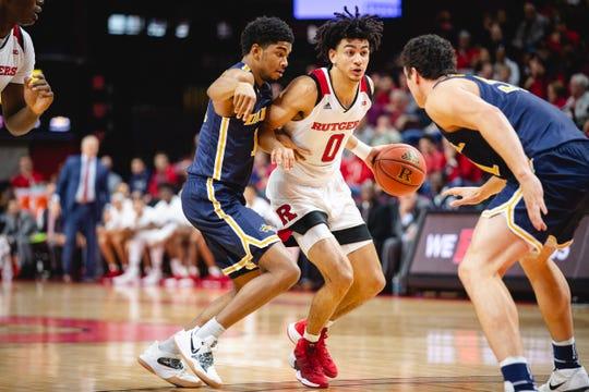 Rutgers Geo Baker drives against Drexel