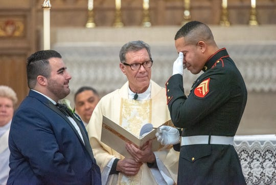 Christian Fuscarino, (left) Executive Director of Garden State Equality, and U.S. Marine Corporal Aaron Williams were married at Trinity Church in Asbury Park on Sunday, November 11, 2018. Gov. Phil Murphy spoke at the ceremony.