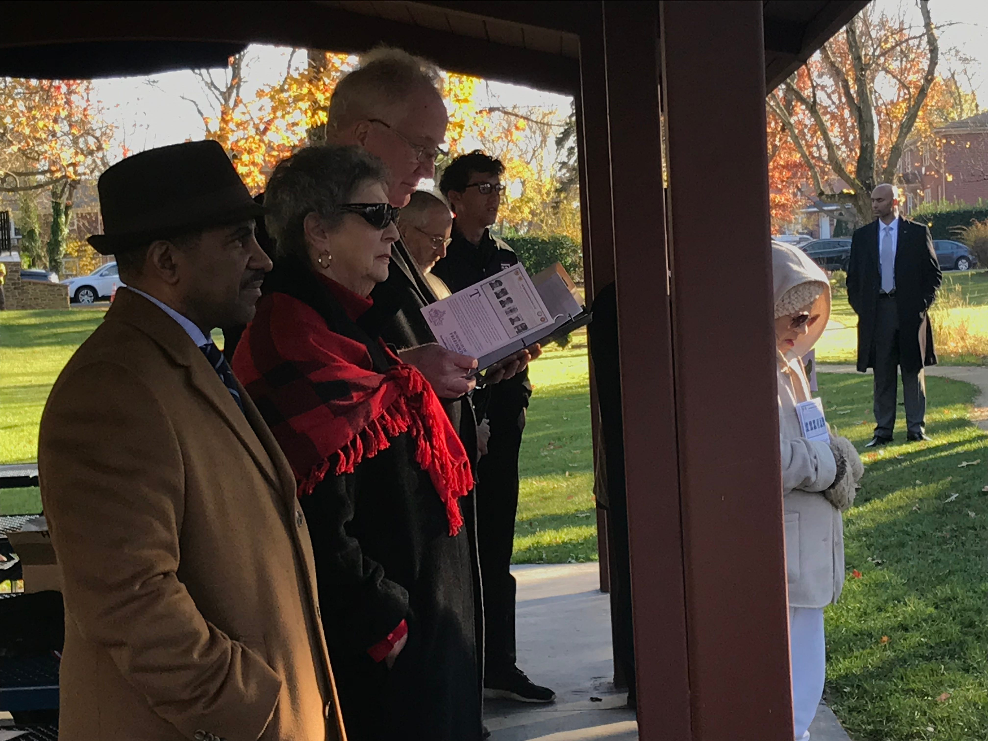 From left, the Rev. Ronald Sparks, councilwoman Sharon Shutzer, mayor J. Nolans Higgin, town historian Kevin Coyne and youth government alumnus Ricky Coyne watch as public officials deliver remarks during the re-dedication ceremony for Freehold's six Lewis brothers who served in World War II.