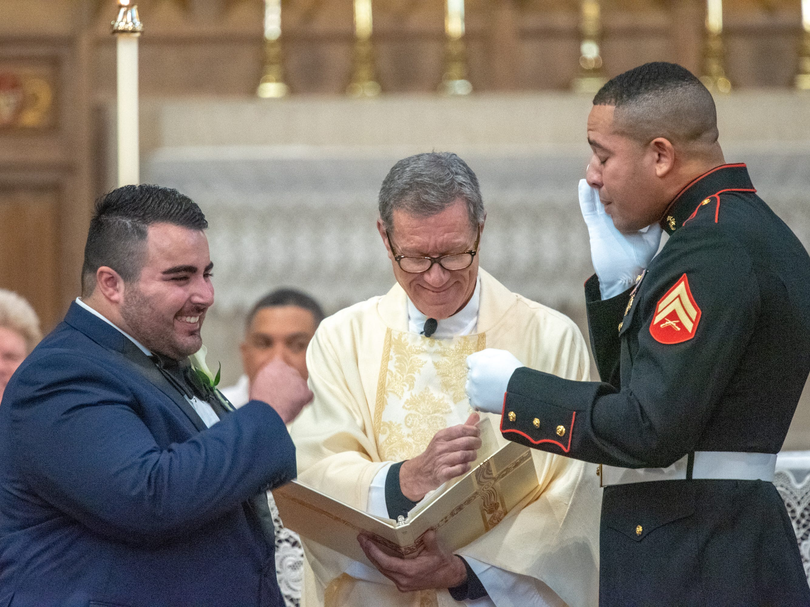Christian Fuscarino, (left) Executive Director of Garden State Equality, and U.S. Marine Corporal Aaron Williams were married at Trinity Church in Asbury Park on Sunday, November 11, 2018.