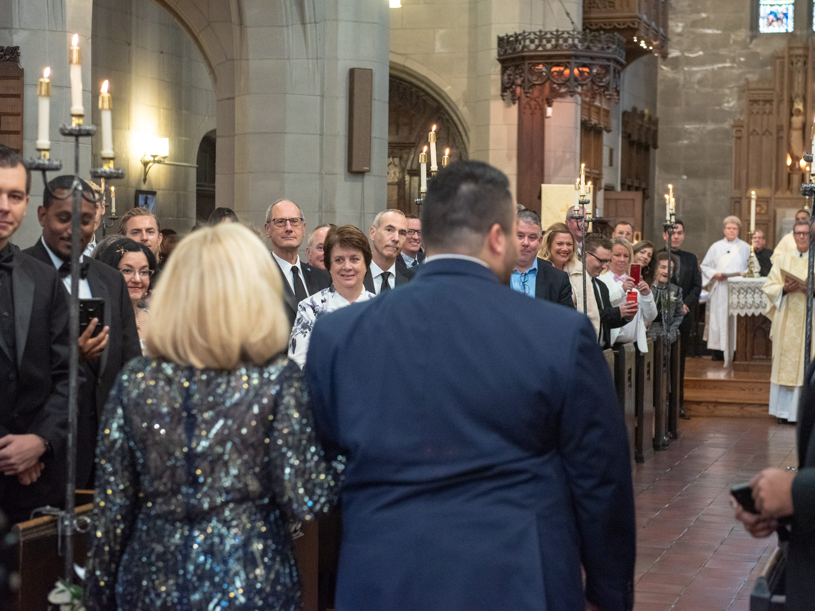 Christian Fuscarino, (entering with his mother) Executive Director of Garden State Equality, walks down the isle of Trinity Church in Asbury Park on Sunday, November 11, 2018.
