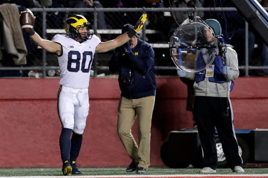 Michigan wide receiver Oliver Martin celebrates his touchdown on a pass from quarterback Shea Patterson during the second half of an NCAA college football game against Rutgers, Saturday, Nov. 10, 2018, in Piscataway, N.J. (AP Photo/Julio Cortez)