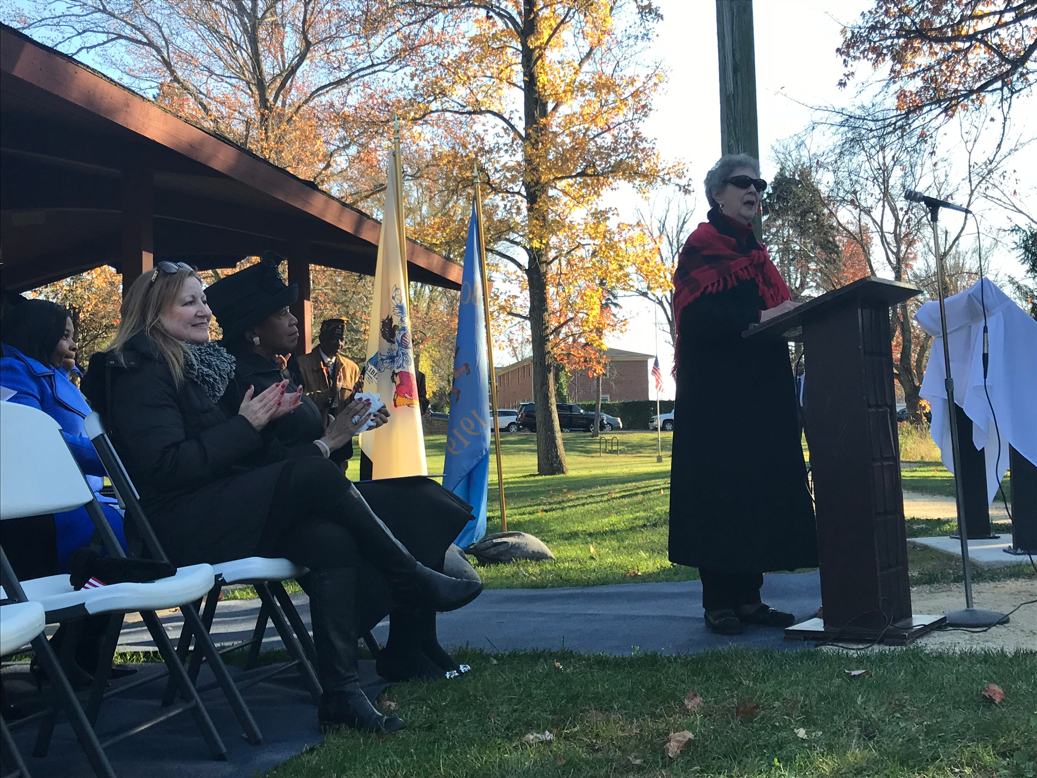 Freehold Borough councilwoman Sharon Shutzer, right, announced the guests at the Veterans Park re-dedication ceremony, including (left) Assemblywoman Joann Downey and Lt. Gov. Sheila Oliver. The ceremony commemorated the six Lewis brothers from Freehold Borough who served in World War II.
