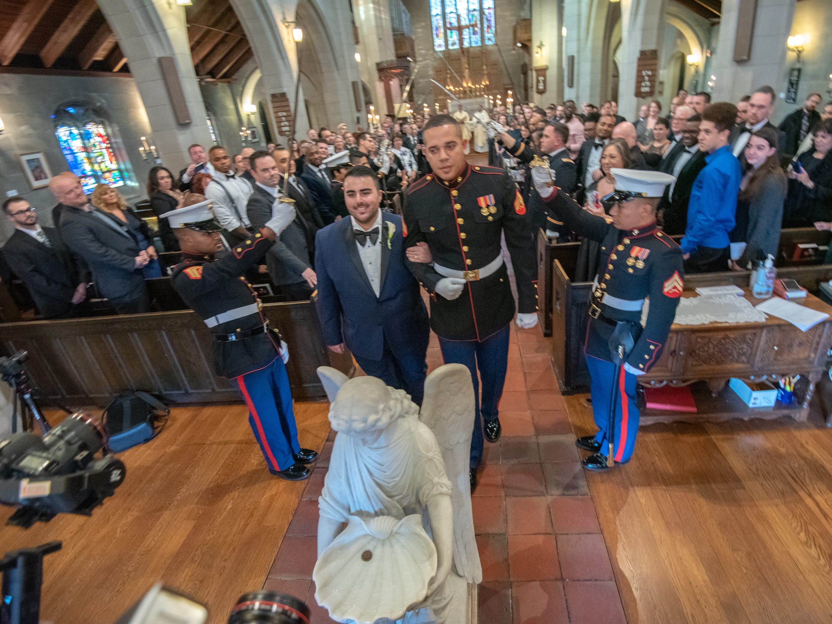 Christian Fuscarino, (left) Executive Director of Garden State Equality, and U.S. Marines Corporal Aaron Williams (in uniform) were married at Trinity Church in Asbury Park on Sunday, November 11, 2018.
