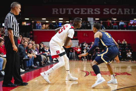 Rutgers forward Issa Thiam handles against Drexel