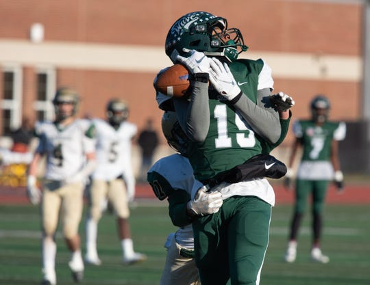 Niles Montgomery (15) of Long Branch makes an over-the-back touchdown catch as the first half came to an end. Brick Memorial traveled to Long Branch to play the NJSIAA Central Group IV semifinal football game on Saturday, November 10, 2018. / Russ DeSantis for the Asbury Park Press