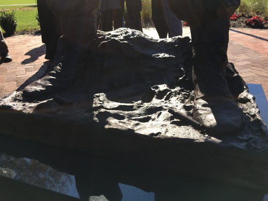 The base of the Gen. Rockafeller statue includes shell casings from World War II that were recently found in Europe.