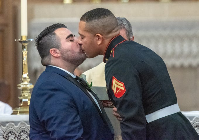 Christian Fuscarino, (left)Executive Director of Garden State Equality, and U.S. Marine Corporal Aaron Williams have their first kiss as a married couple. They were married at Trinity Church in Asbury Park on Sunday, November 11, 2018.
