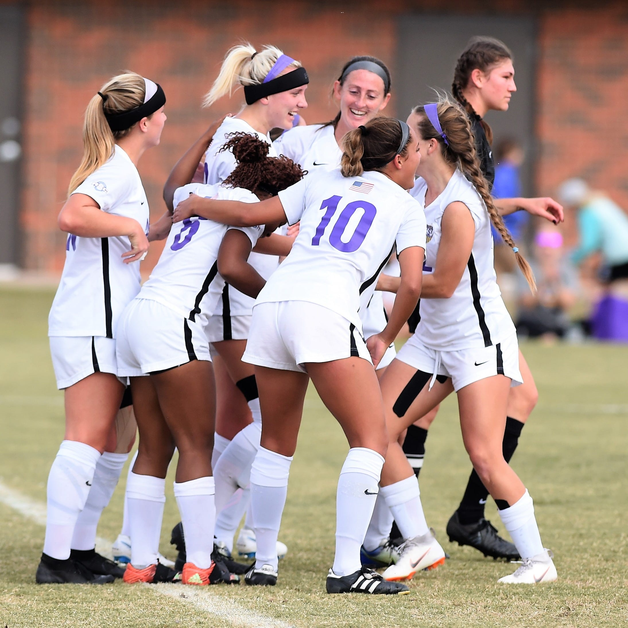 Hardin-Simmons defender Baylee Ford (23) is congratulated by teammates after scoring against Trinity in the second round of the NCAA Division III tournament at the HSU Soccer Complex on Sunday, Nov. 11, 2018.