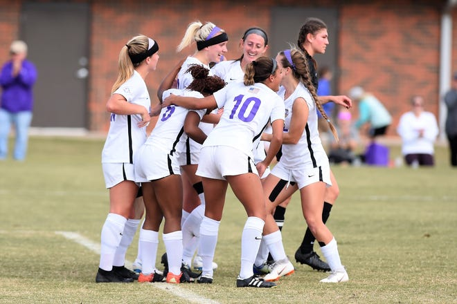 Hardin-Simmons defender Baylee Ford (23) is congratulated by teammates after scoring against Trinity in the second round of the NCAA Division III tournament at the HSU Soccer Complex on Sunday. Ford scored twice as HSU blanked its Texas rival 3-0 to advance to third round.