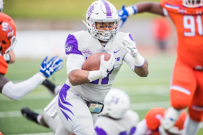ACU running back Tracy James carries the ball during the Wildcats' game against Sam Houston State. James ran for a game-high 111 yards, including a TD, in ACU's 17-10 victory over the Bearkats on Saturday, Nov. 10, 2018, in Huntsville.