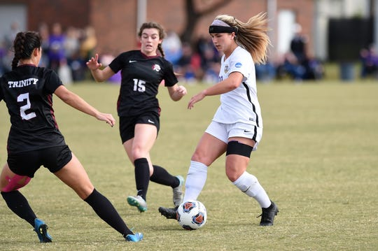 Hardin-Simmons midfielder Kenne Kessler (28) slides a pass past a Trinity defender in the second round of the NCAA Division III tournament at the HSU Soccer Complex.