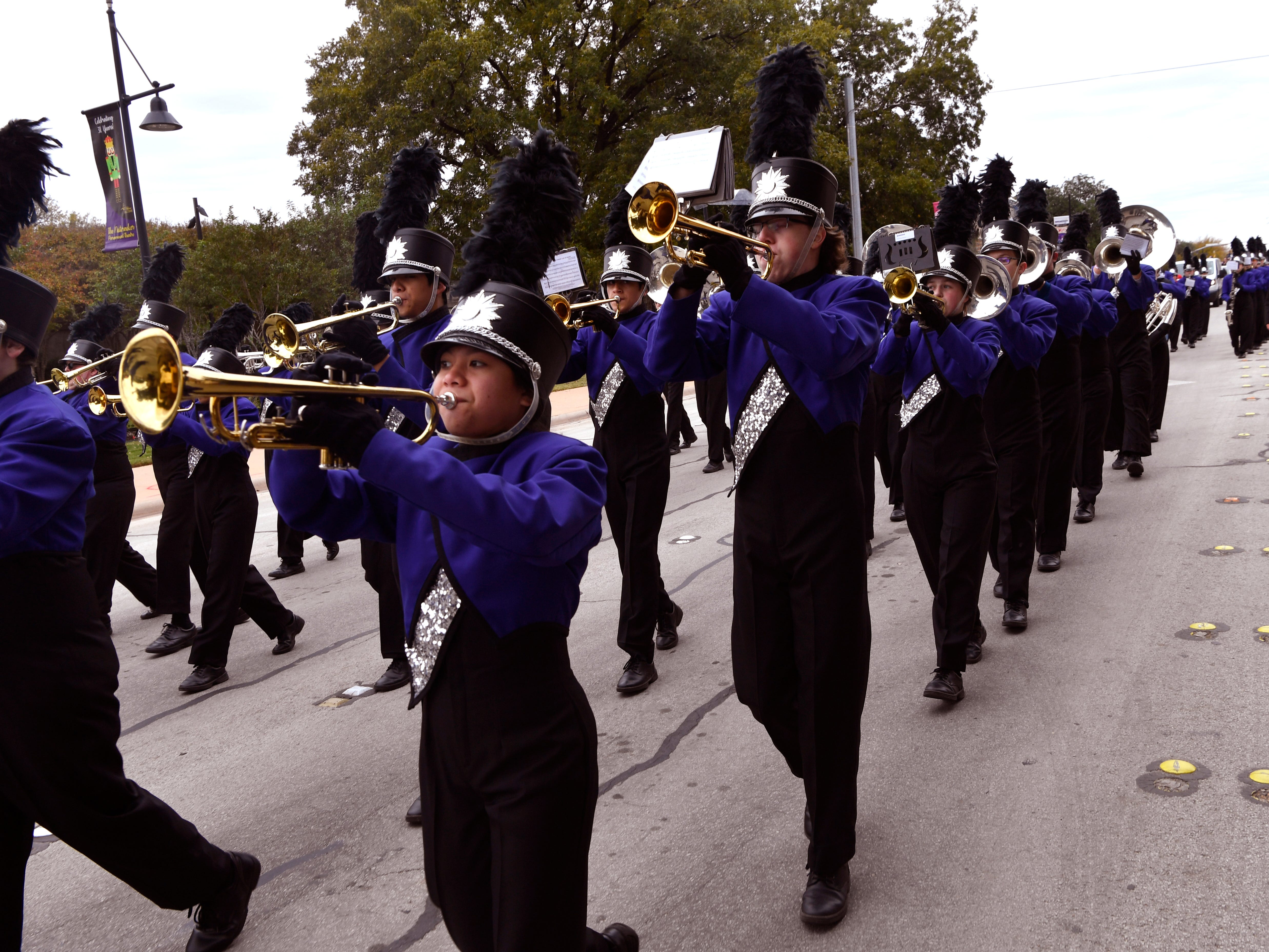 Members of the Wylie High School Pure Gold Band march during Saturday's Veterans Day parade Nov. 10, 2018.