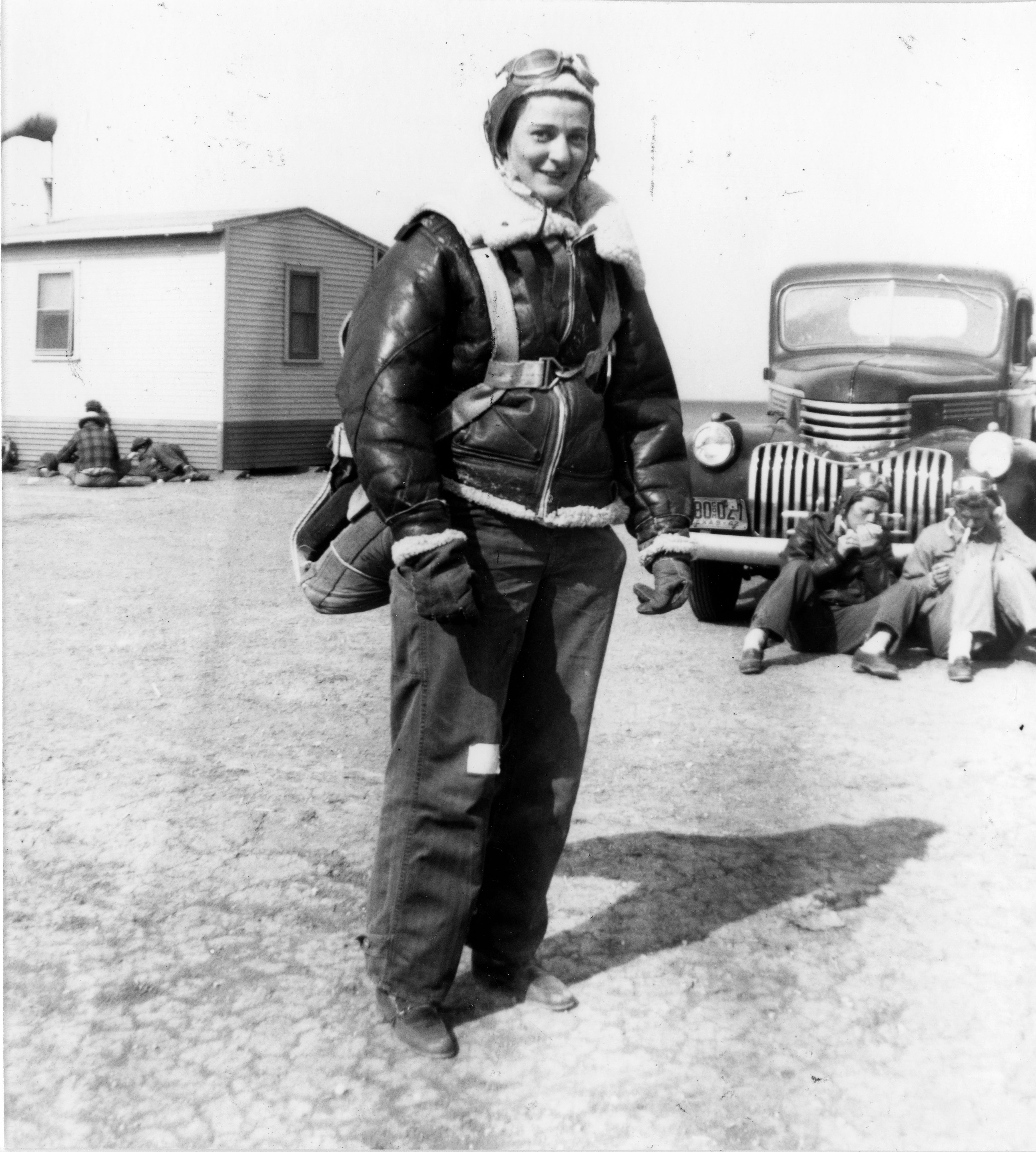 """Bernice """"Bee"""" Haydu, a Women's Airforce Service Pilot, or WASP, during World War II, prepares to fly a Stearman Kaydet during flight training at an auxiliary field near Avenger Field in Sweetwater, Texas, in 1944. Because the plane was an open cockpit bi-plane, during the winter months, the pilots wore winter gear such as a fleece-lines helmet and pants. They would make flight notes on the adhesive tape on the pants."""