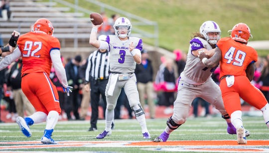 ACU quarterback Luke Anthony gets ready to throw the ball against the Sam Houston State defense. The Wildcats won the game 17-10 on Saturday, Nov. 10, 2018, in Huntsville.