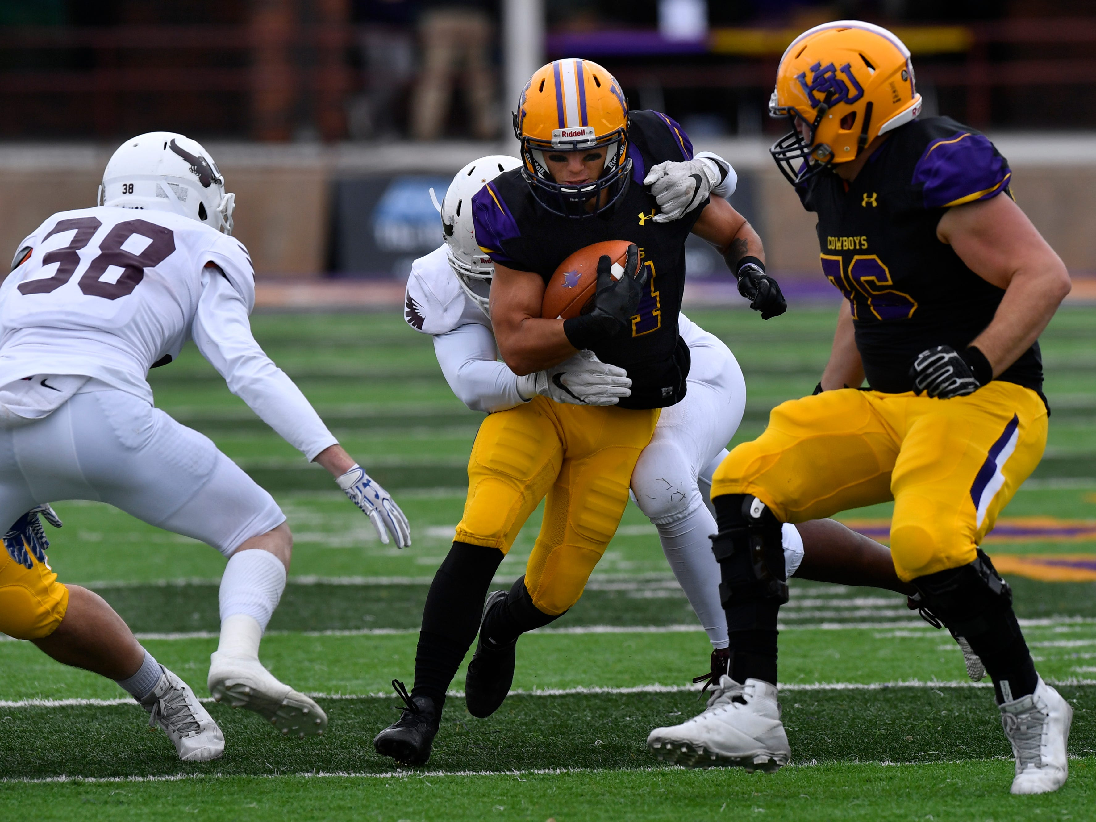 Cowboys running back Bryson Hammonds is tackled while carrying the ball downfield during Saturday's game against McMurry University at HSU Nov. 10, 2018. Final score was 83-6, Hardin-Simmons University.