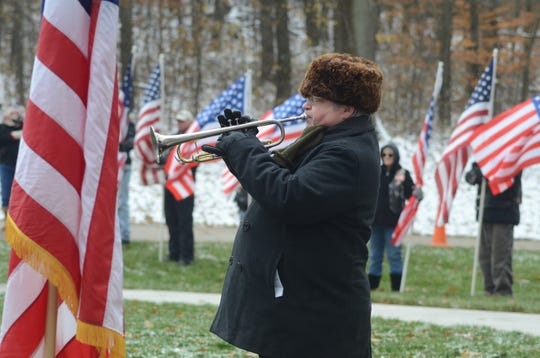 Nick Batch plays taps to end the ceremony.