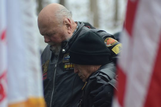 Vietnam veterans and brothers-in-law Fred Gramza, left, and Paul Bolton embrace during a prayer.
