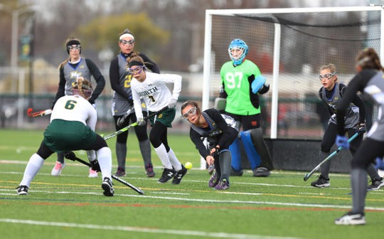 Maine-Endwell 's Jenna Zunic hits the ball away from the goal that Williamsville North's Jenna Piotrowski tried to score on Maine-Endwell.  Maine-Endwell beat Williamsville North  4-1 to win the state championship.