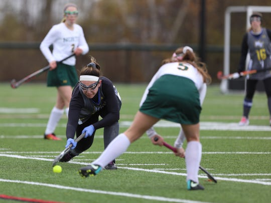 Maine-Endwell's Reagan McQuade tries to get by Williamsville North's Jordan Cooper,  Maine-Endwell beat Williamsville North 4-1.