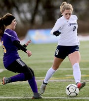 Chenango Forks' Lauren Ashman prepares to strike the ball during Sunday's Class B state title game against Holland Patent at Cortland High. Ashman scored a goal in the Blue Devils' 2-0 victory.