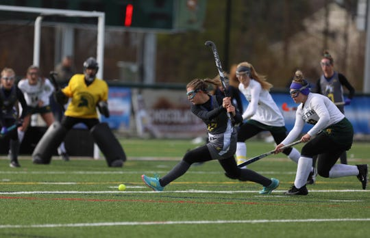 Maine-Endwell's Anna Castaldo winds up to hit the ball with Williamsville North's Ryleigh Bles defending.  The two teams played at Williamsville North High School with Maine-Endwell winning the state championship.