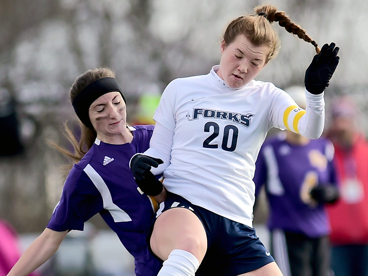 Holland Patent's Samantha Buley (17) and Chenango Fork's Emma Bough (20) battle for the ball during Chenango Forks vs. Holland Patent, Class B NYSPHSAA Girls Soccer Championship , Cortland High School, Cortland, NY. Sunday, November 11, 2018.