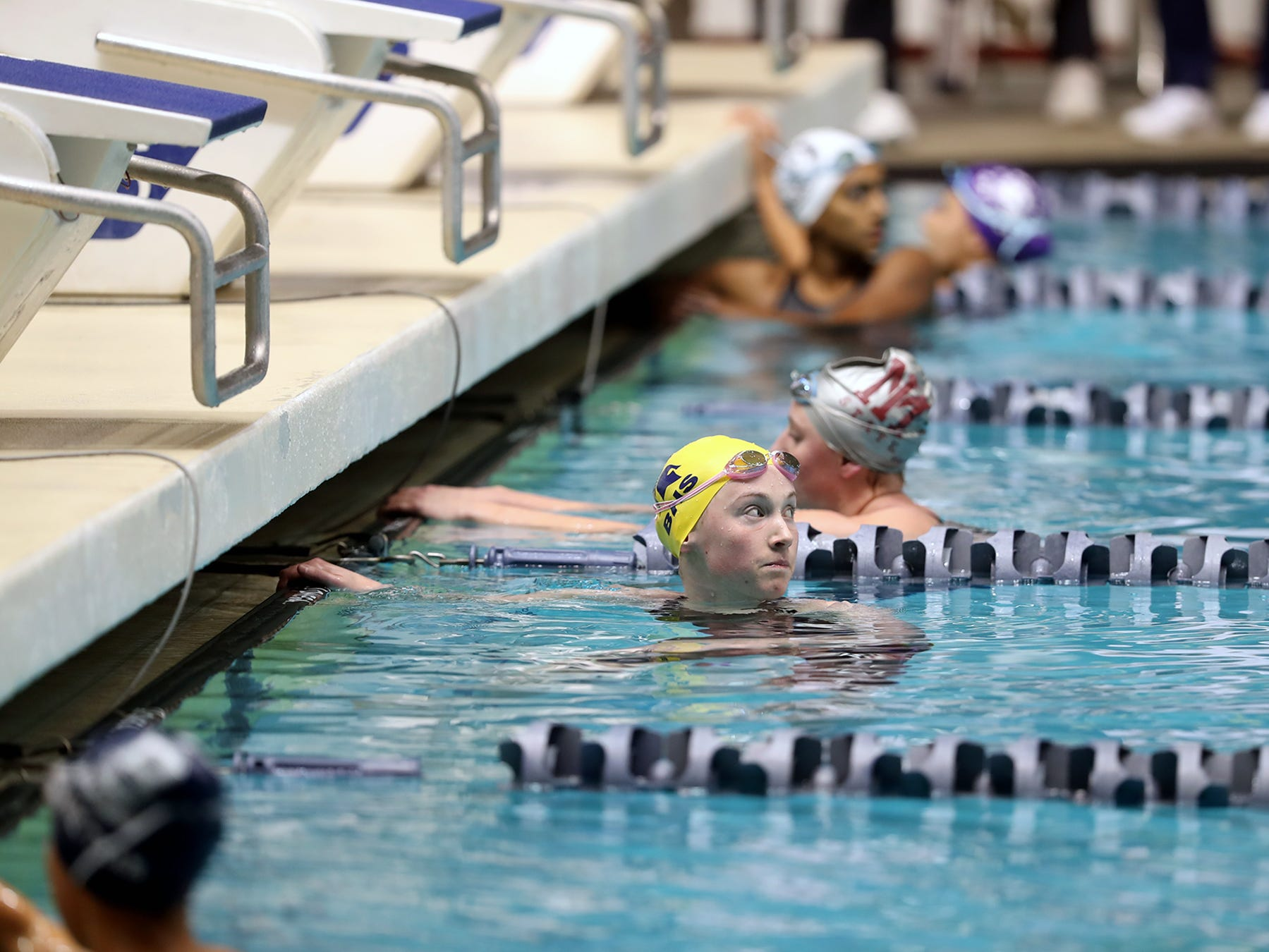 Bainbridge  swimmer Margaret Hayes looks back to the scoreboard after  the 3A girls 200 IM medley at the Washington State Swim & Diving Championships at the King County Aquatic Center on Saturday, November, 10, 2018.She lead the whole race but was disqualified.