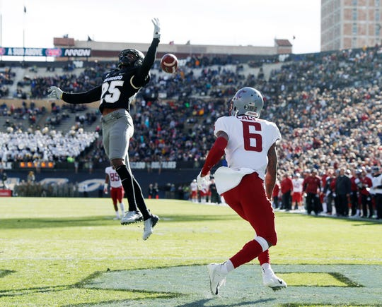Colorado cornerback Mekhi Blackmon (left) deflects a pass intended for Washington State wide receiver Jamire Calvin in the end zone.