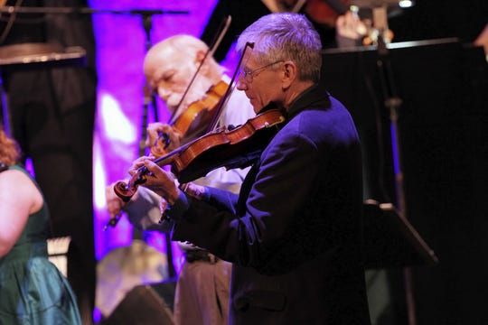 Bob Childs, like all the other fiddlers on the ChildsPlay tour, plays a violin he made himself.