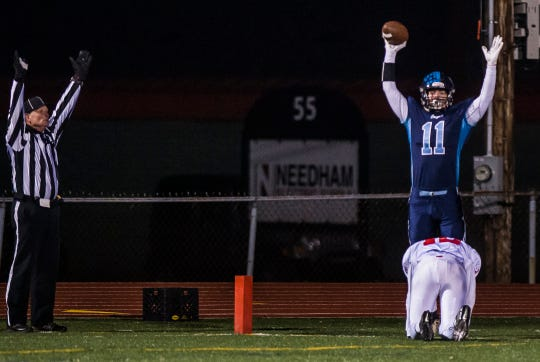 MMU's Harrison Leombruno-Nicholson (11)  gets his fingertips on a pass from QB Asa Carlson and hangs on against Rutland's  Brady Kenosh for the touchdown during their Division I high school football championship game in Rutland on Saturday, Nov. 10, 2018. Mount Mansfield won, 38-27.