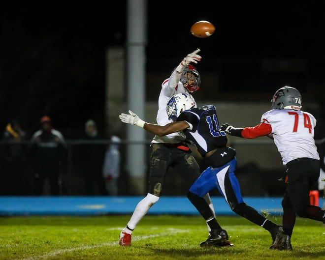 Williamstown's Donovan Ezeiruaku hits Vineland's quarterback Tyreem Powell during their South Jersey Group 5 semifinal round playoff game.