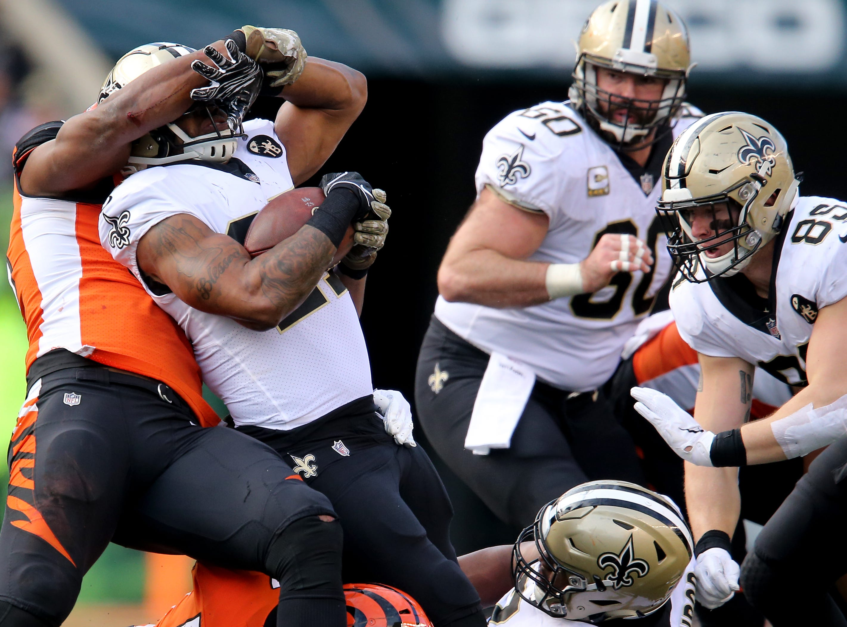 New Orleans Saints running back Dwayne Washington (27) tries to push Cincinnati Bengals defensive end Michael Johnson (90) hand away on a carry in the fourth quarter of a Week 10 NFL game between the New Orleans Saints and the Cincinnati Bengals, Sunday, Nov. 11, 2018, at Paul Brown Stadium in Cincinnati. The New Orleans Saints won 51-14.