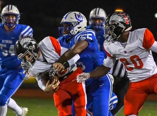 Wyoming linebacker Hasan Black (55) tackles Cole Dein of Indian Hill in the OHSAA D4 Region 16 Playoffs at Lakota West High School, Saturday, Nov. 10, 2018