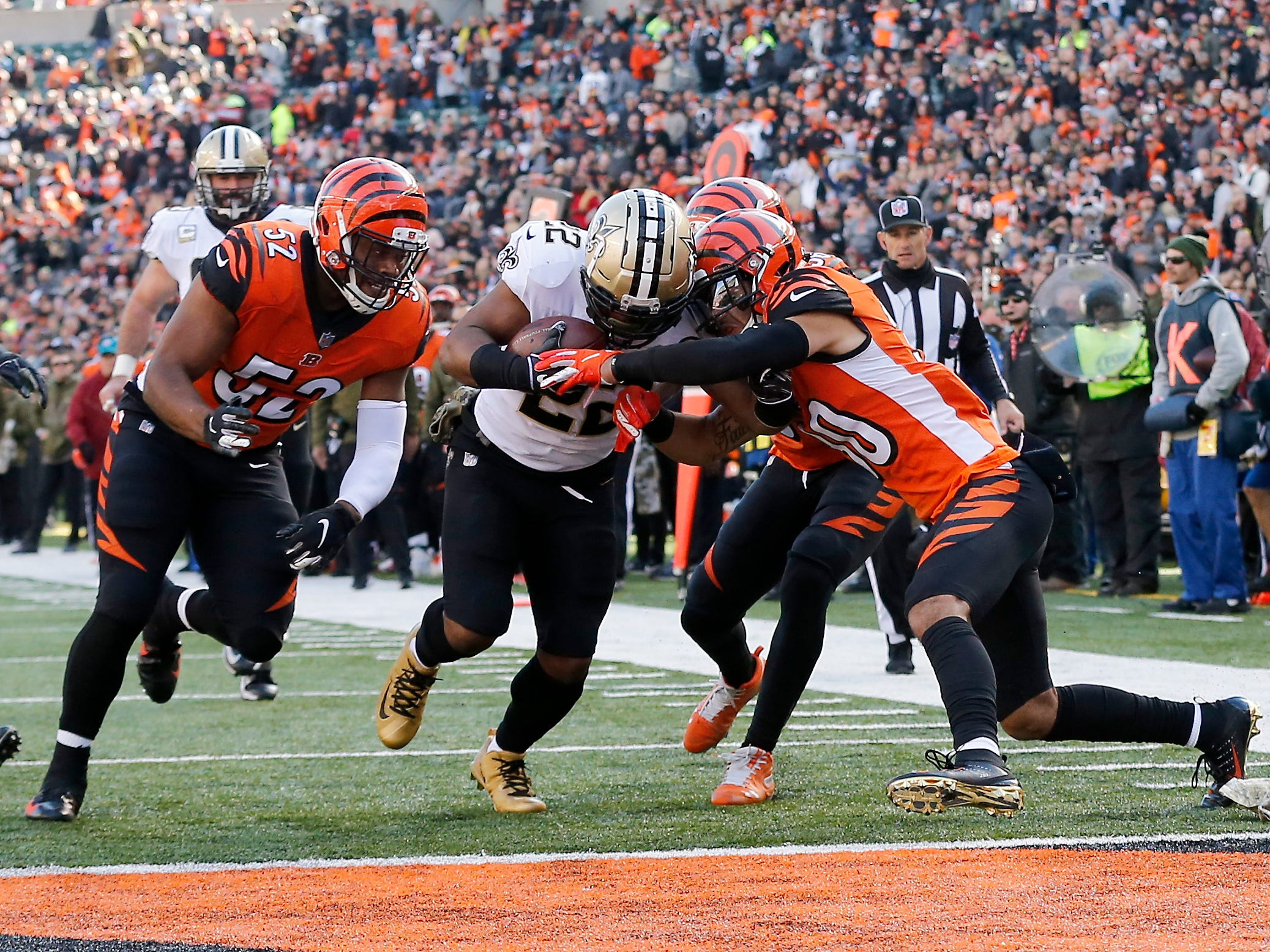 New Orleans Saints running back Mark Ingram (22) pushes through a group of Bengals defenders for a touchdown in the second quarter of the NFL Week 10 game between the Cincinnati Bengals and the New Orleans Saints at Paul Brown Stadium in downtown Cincinnati on Sunday, Nov. 11, 2018. The Saints led 35-7 at halftime.