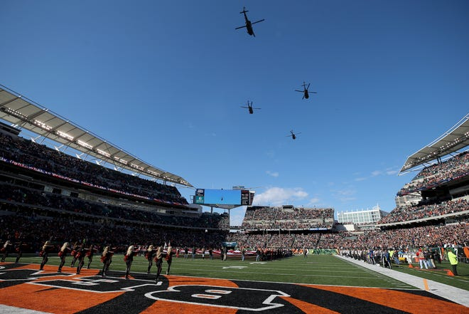 Military helicopters fly over Paul Brown Stadium before the start of a Week 10 NFL game between the New Orleans Saints and the Cincinnati Bengals, Sunday, Nov. 11, 2018, in Cincinnati.