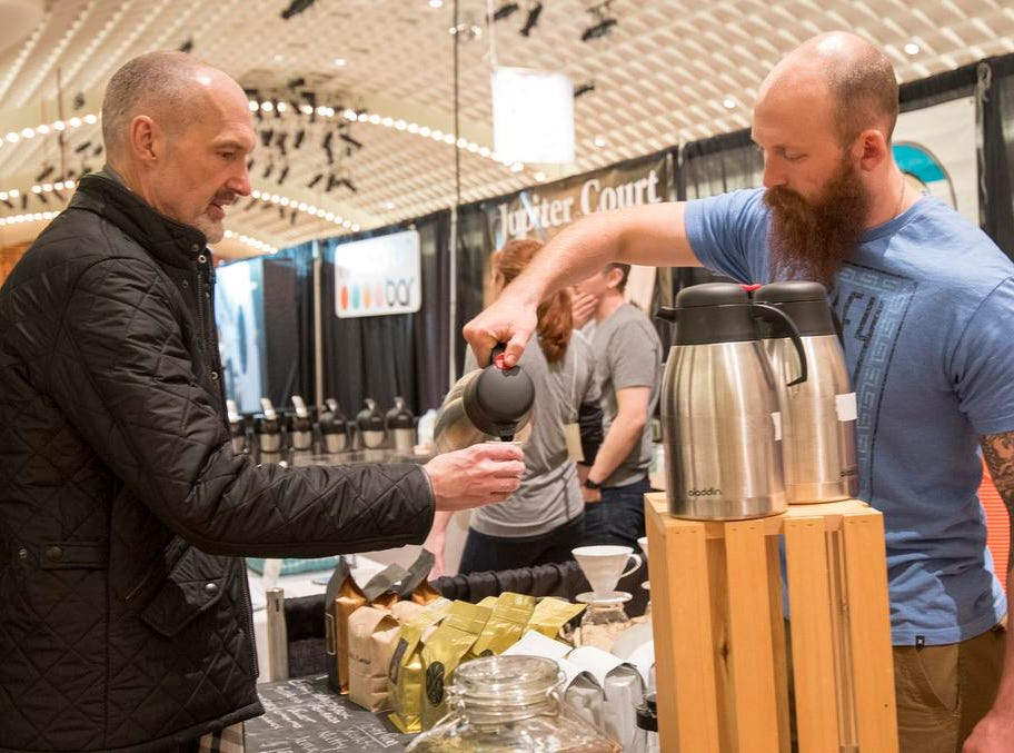 Evan Armstrong of Viking Coffee Co. pours a cup of java for Cary Sierz of Hyde Park during the Cincinnati Coffee Festival at Music Hall Saturday, November 10, 2018 in Cincinnati, Ohio.