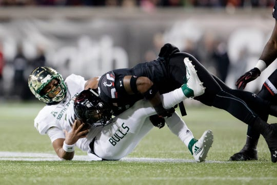 Cincinnati Bearcats linebacker Jarell White (8) tackles South Florida Bulls quarterback Chris Oladokun (10) during the NCAA football game between Cincinnati Bearcats and South Florida Bulls on Saturday, Nov. 10, 2018, at Nippert Stadium in Cincinnati.