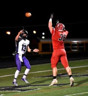 Cole Pelgen (36) of Madison goes vertical to try and block a Cole Fisher pass for CHCA at the Division V region semifinal, November 10, 2018.