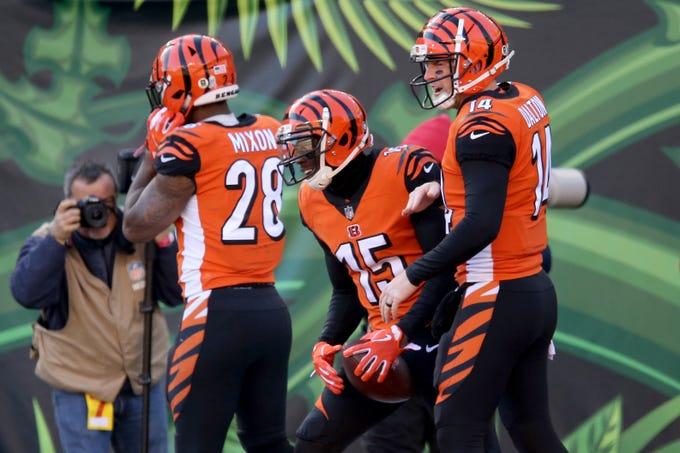 Cincinnati Bengals wide receiver John Ross (15), center, celebrates a touchdown with Cincinnati Bengals quarterback Andy Dalton (14) in the first quarter of a Week 10 NFL game between the New Orleans Saints and the Cincinnati Bengals, Sunday, Nov. 11, 2018, at Paul Brown Stadium in Cincinnati.