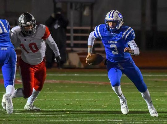 Evan Prater of Wyoming runs the football against Indian Hill in the OHSAA D4 Region 16 Playoffs at Lakota West High School, Saturday, Nov. 10, 2018